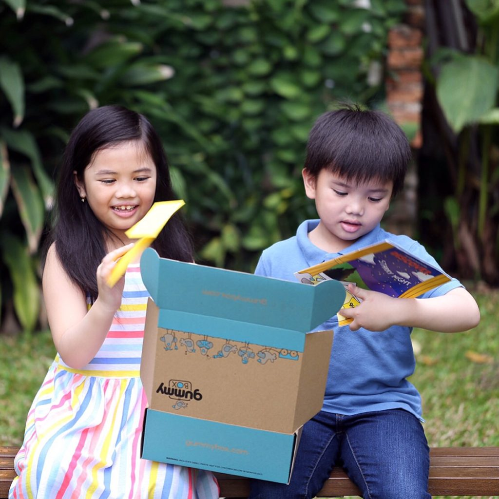 two kids unboxing a gummybox